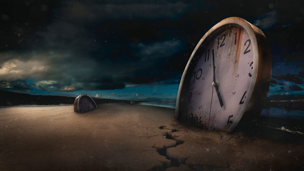 Digital print of a clock in the sand with a dark sky