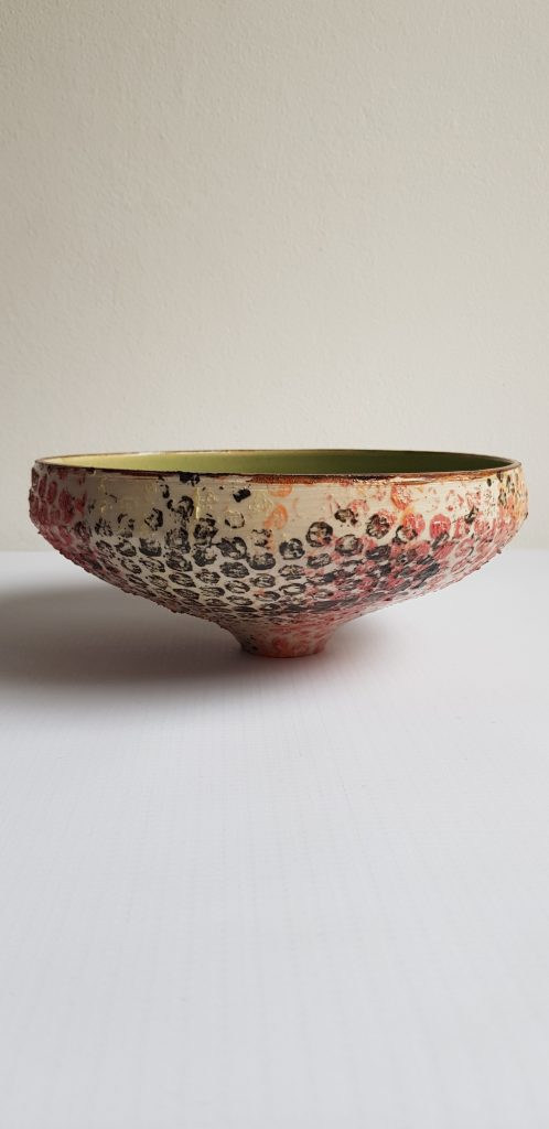 Shallow ceramic dish with dabbled colour on the outside