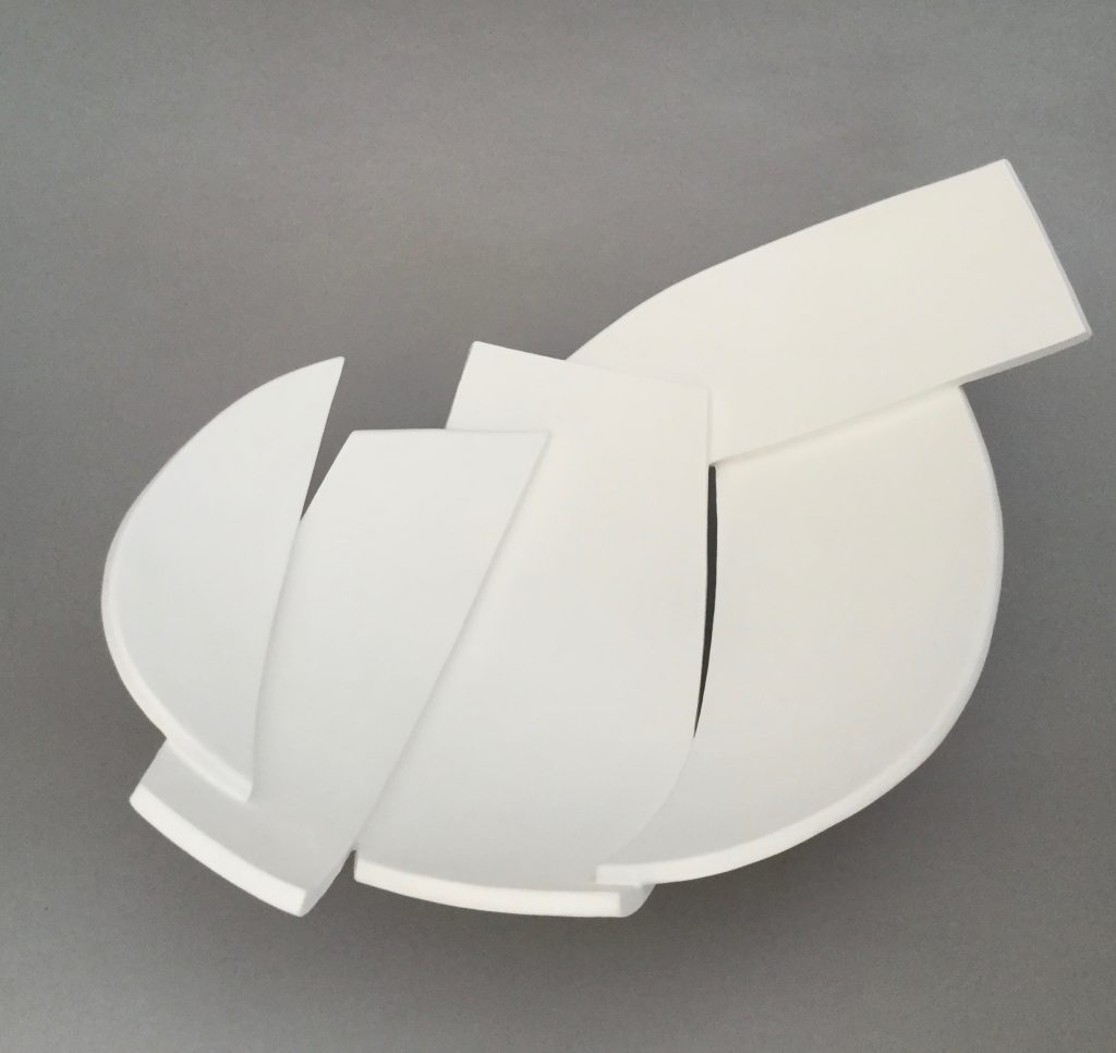 Shallow ceramic dish of abstract forms – in white