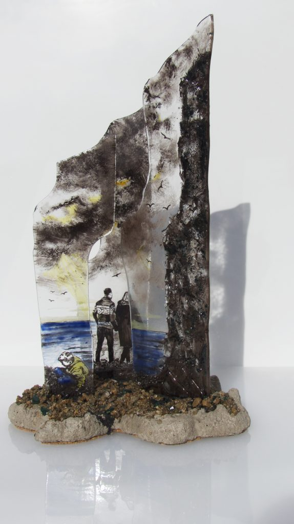 Mixed media sculpture incorporating painted glass depicting figures by the sea