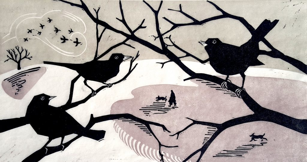 Lino print of birds on branches