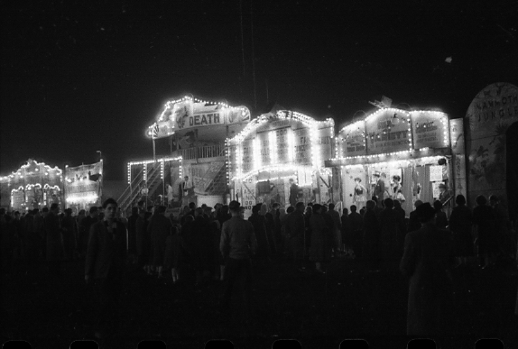 A black and white photograph of Hull Fair at night in the 1940s