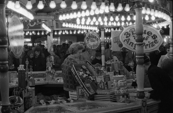 Black and white photograph of a sweet stall at Hull Fair
