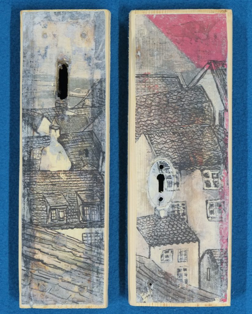 Mixed media work on reclaimed wood, showing coastal rooftops