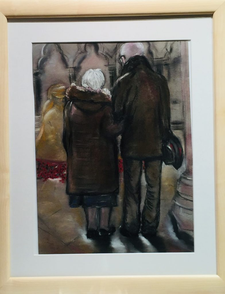 A pastel work of an older couple walking arm in arm