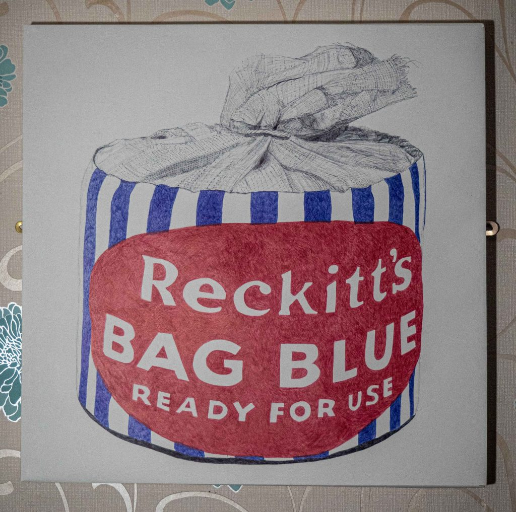 Pen and ink drawing of a blue-striped packet of Reckitt's