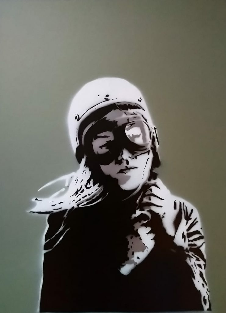 Black and white mixed media work of a girl in helmet and goggles