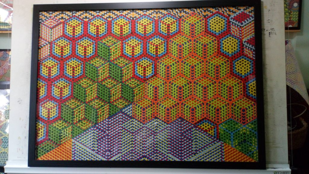Pen and ink drawing of bright colourful cubes