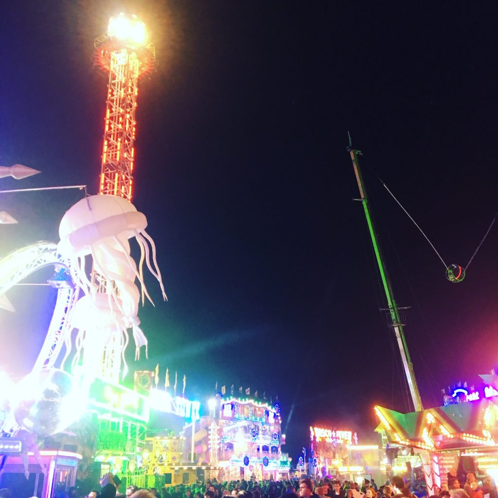 A colour photograph looking up at the lights of Hull Fair, 2018