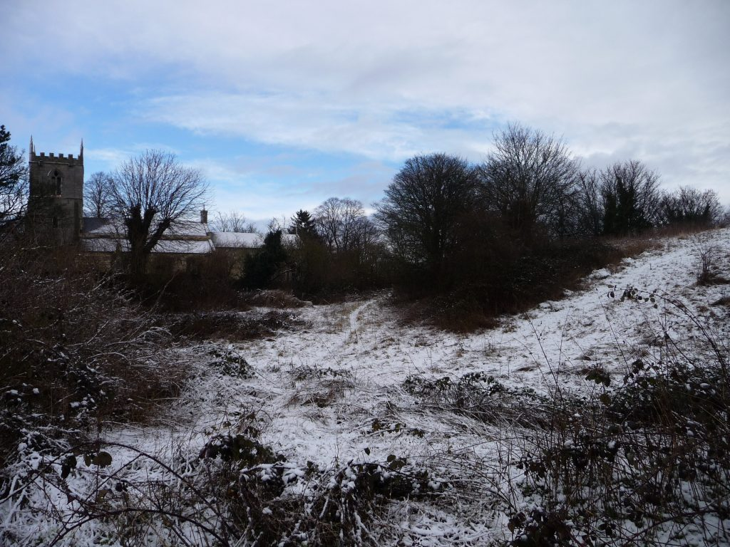 The mound next to Owston Ferry Church where Kinard Castle once stood