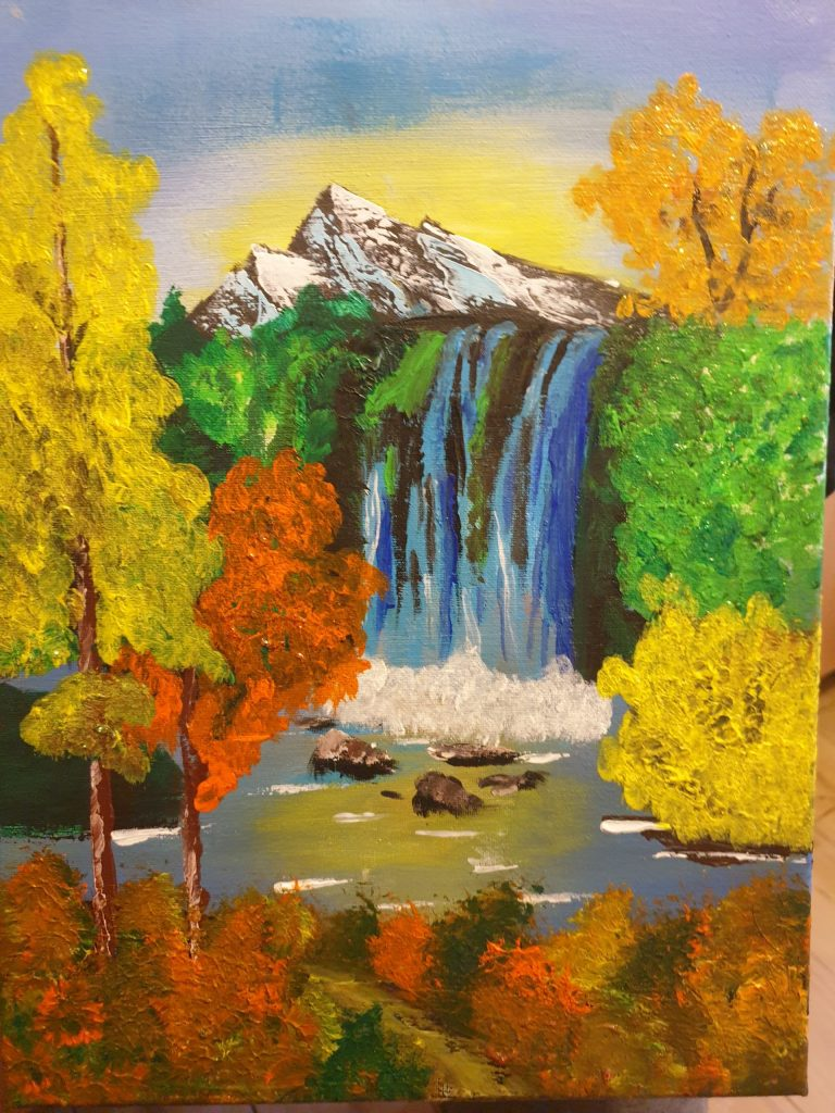 Painting of an autumn landscape with a waterfall and mountain in the distance.