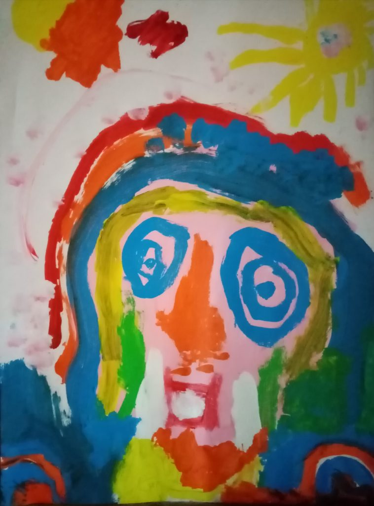 Colourful painting of a face.
