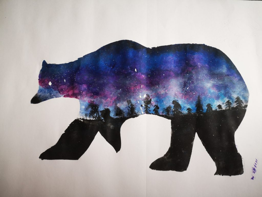 A picture of bear silhouette, filled with galaxy print.