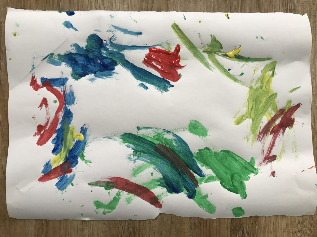 An abstract child's painting in various colours.