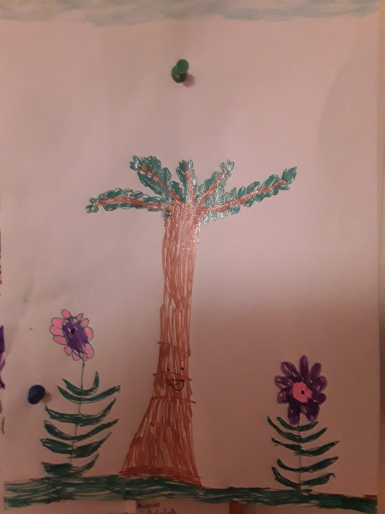 A colour drawing of tree with a tall flower either side.