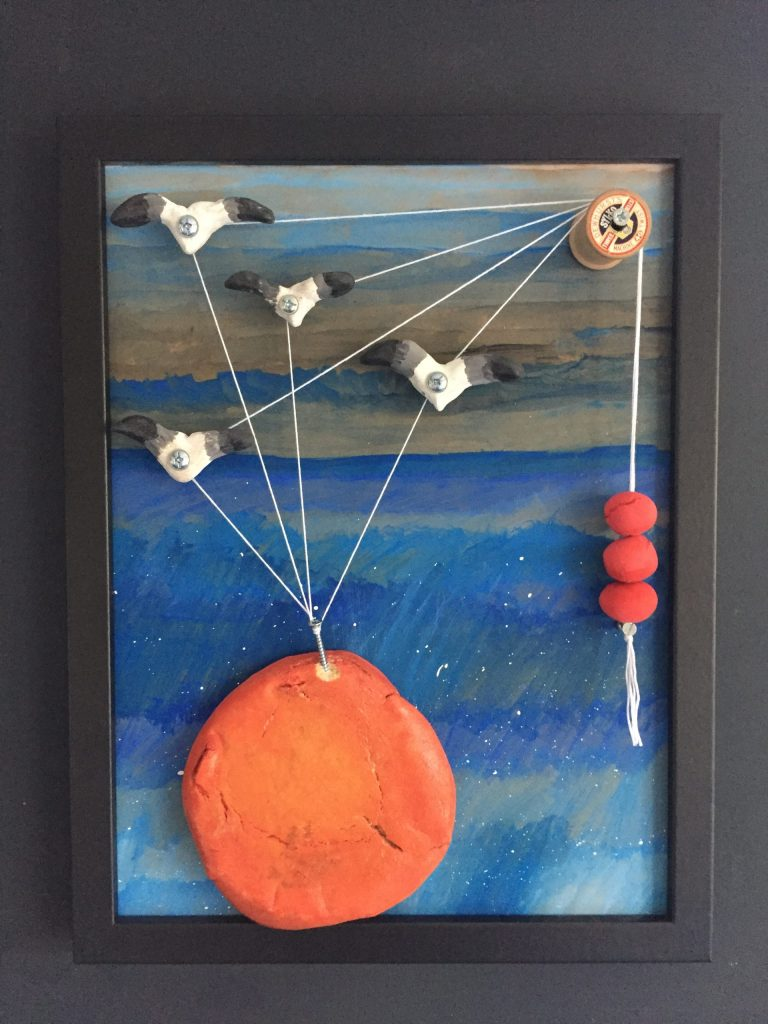Mixed media artwork of birds carrying a large peach.