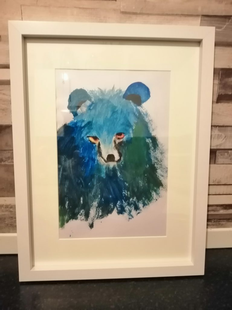 Framed painting of a blue bear.