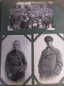 Three photographs inset into an album. Top photograph is a crowd of people stood looking at a man in a top hat on a podium. The name Thirsk and Sons can be seen on a shop in the background. Bottom of page is two pictures of men in uniform, one wearing an overcoat.