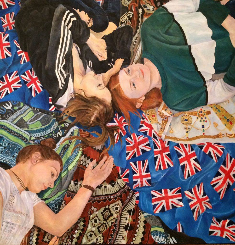 Acrylic painting of three women laid on a pile of blankets