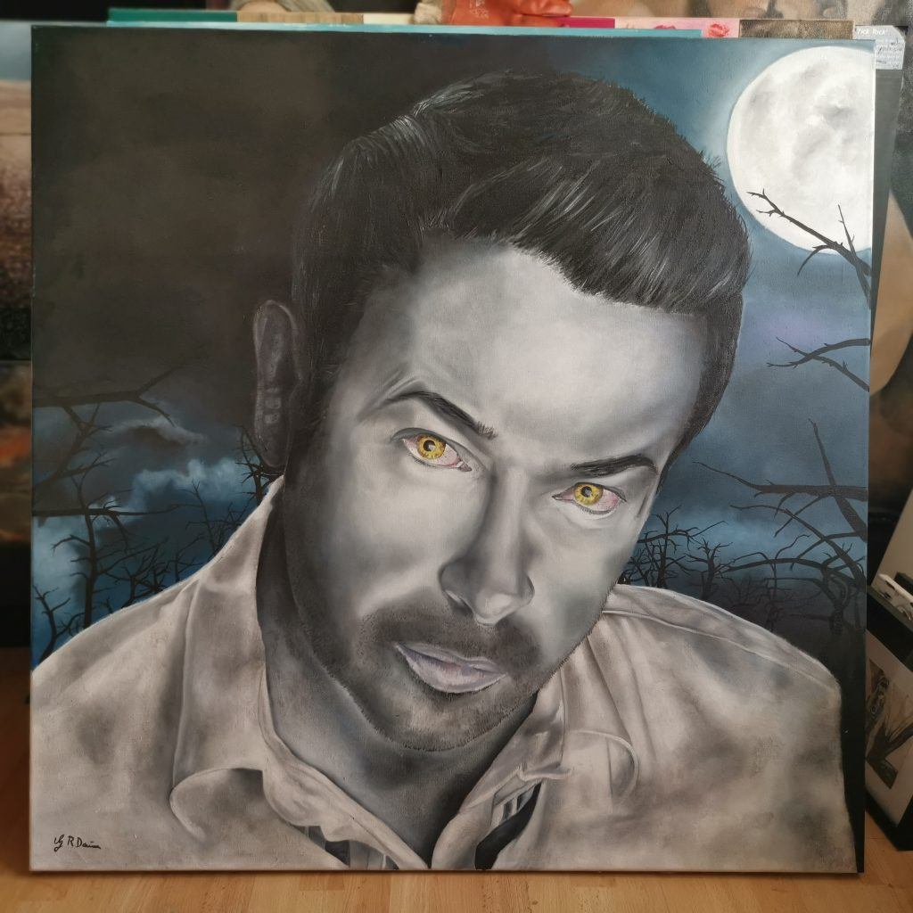 Oil painting of a man with amber eyes set against a dark woodland background