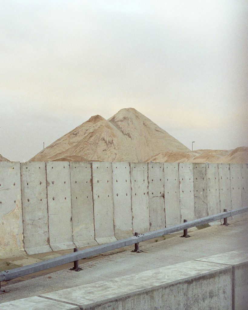 Digital print of concrete barrier in front of a building site