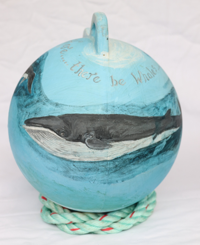 Mixed media painted buoy with a whale