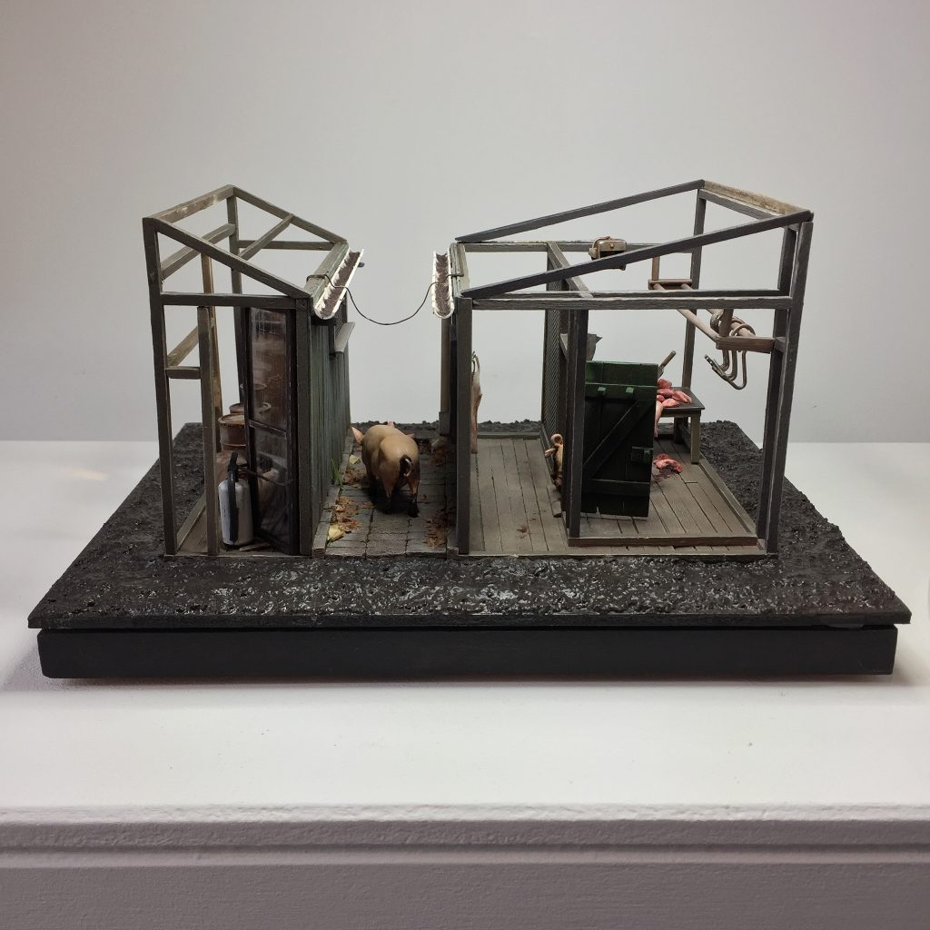 Mixed media scene of pigs within a structure with meat hooks
