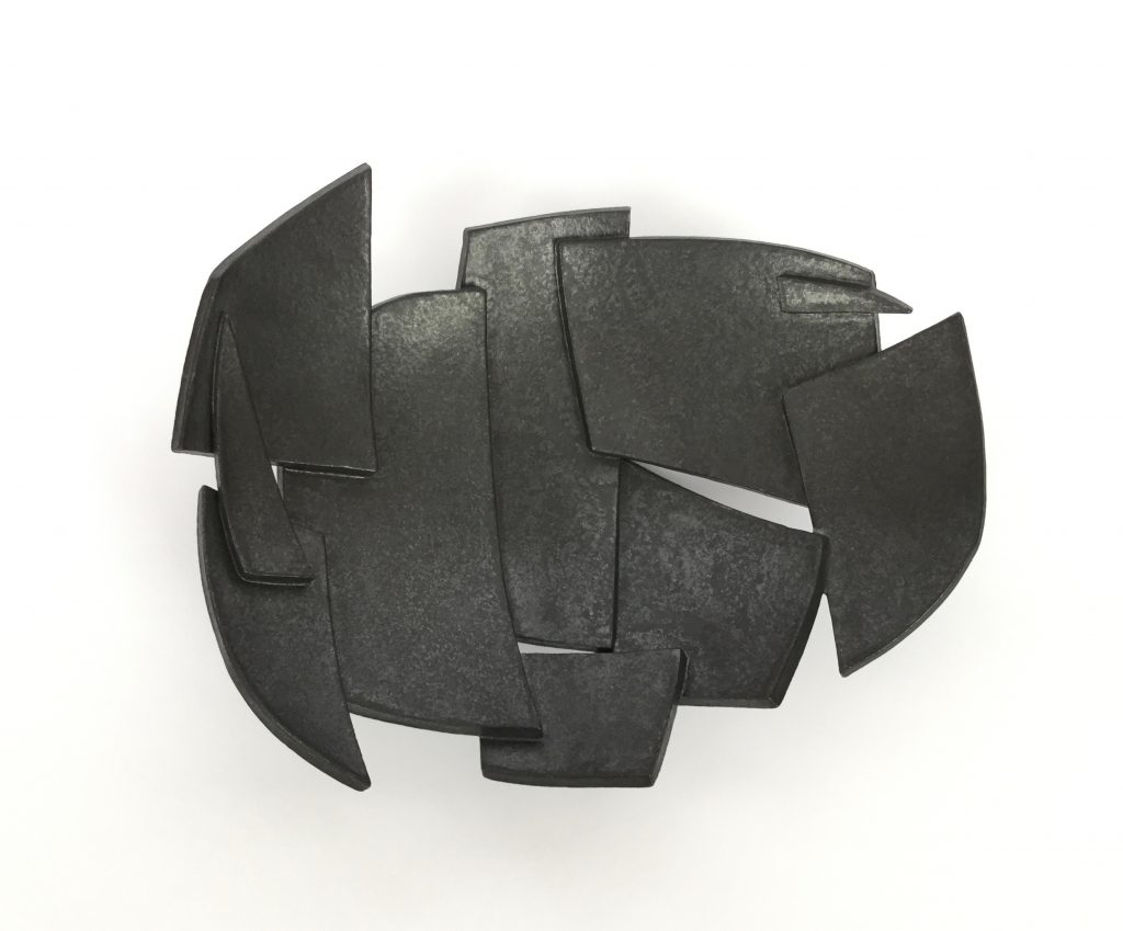 Shallow ceramic dish of abstract forms – in black