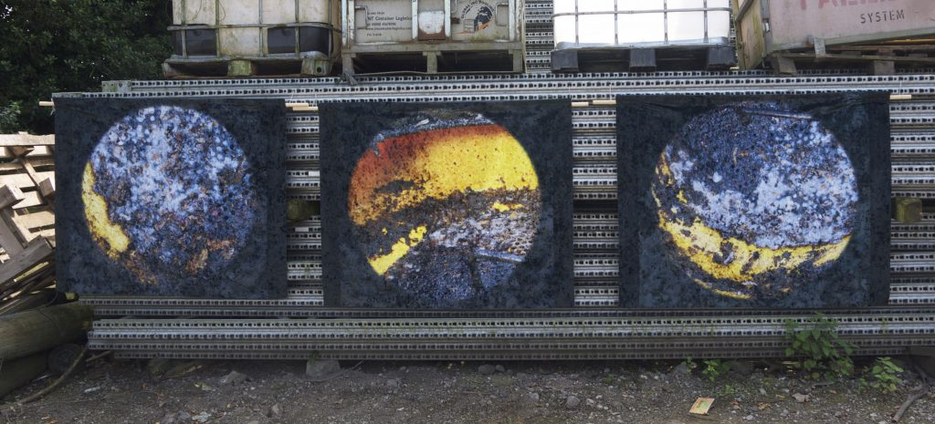 Textile triptych of three colourful spheres