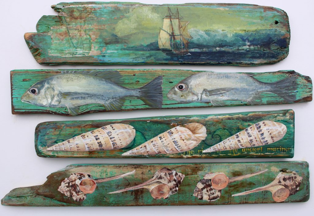 Mixed media work of fish and maritime objects painted on reclaimed wood