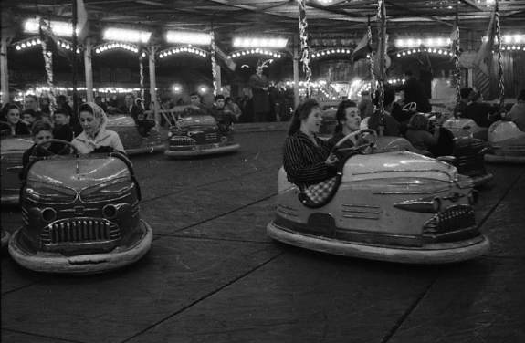 Black and white photograph of the bumper cars