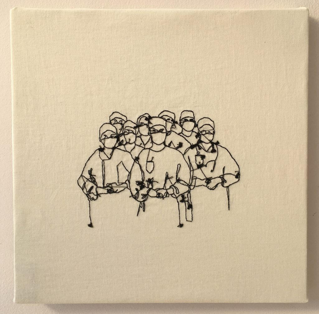 Textile embroidery of a group of doctors in gowns and masks