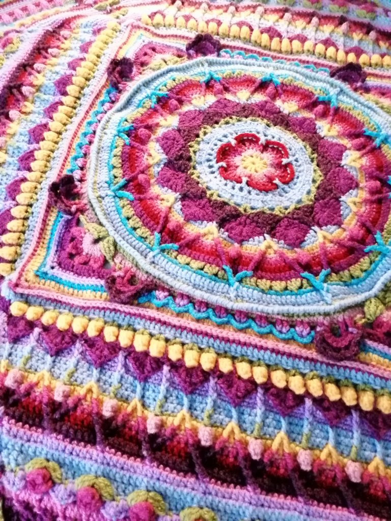 A multicoloured textile work with bright, intricate detail