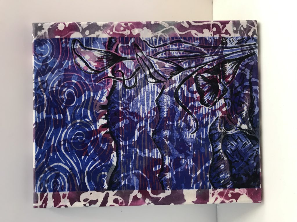 Mixed media work of a castle by the sea, printed on patterned fabric