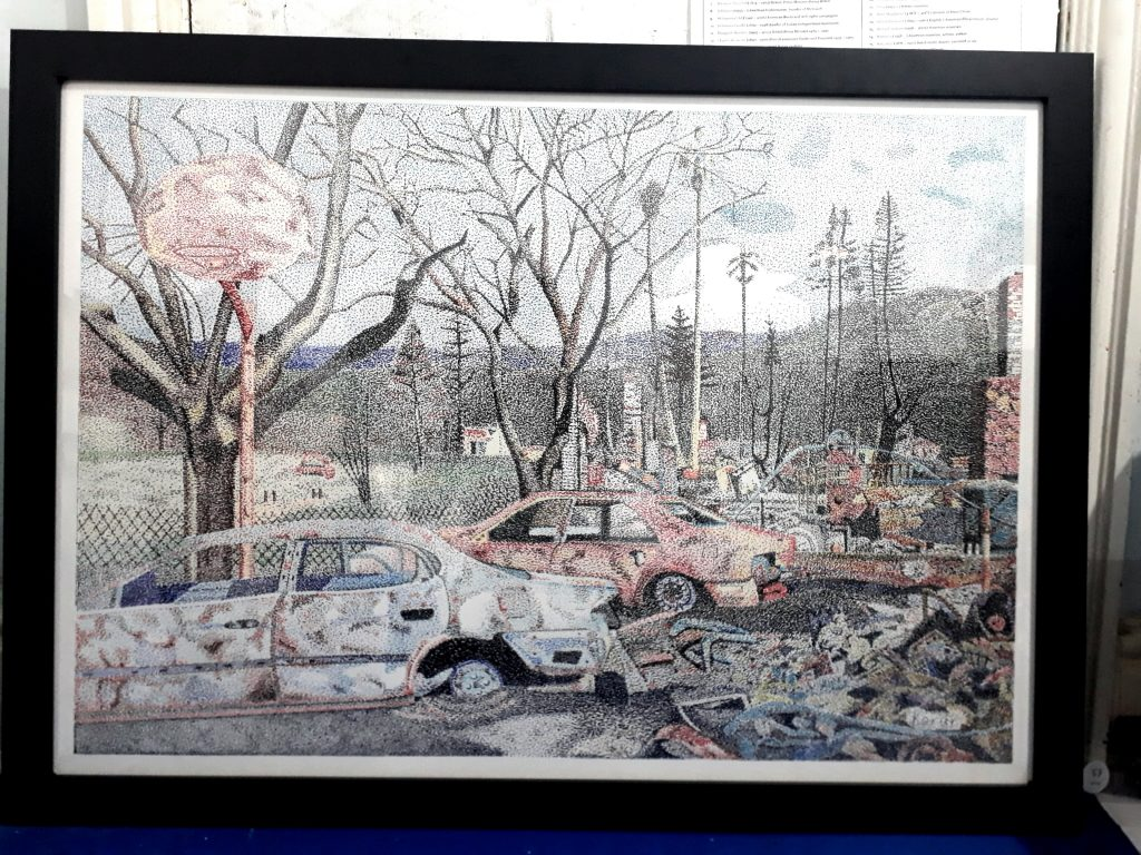 Mixed media work of cars and trees after a wildfire