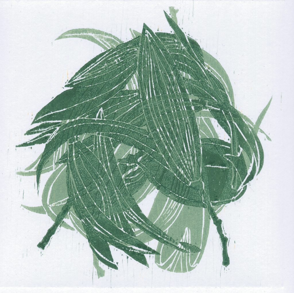 Abstract lino print of leaves, in green