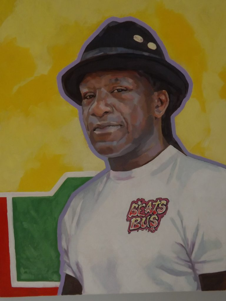 Oil painting portrait of David Okwesia on a bright yellow, green and red background
