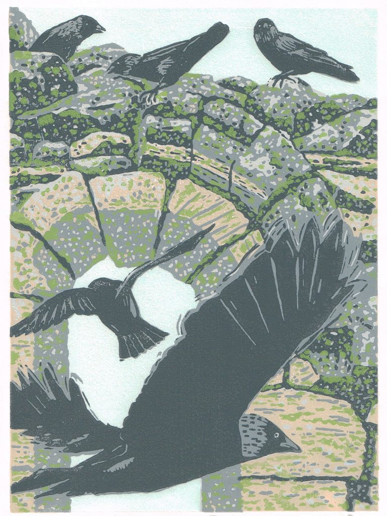 Lino print of jackdaws flying by a brick arch