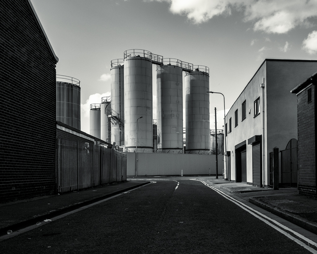 Digital print of an industrial scene, in black and white