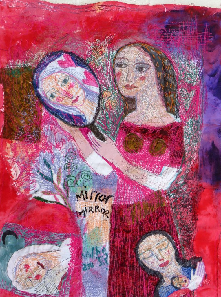 Textile work of a woman looking in a mirror, in pink tones