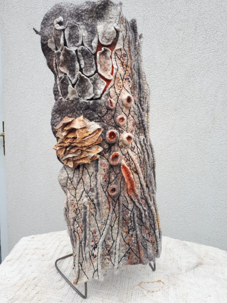 Textile sculpture of a piece of bark with fungus