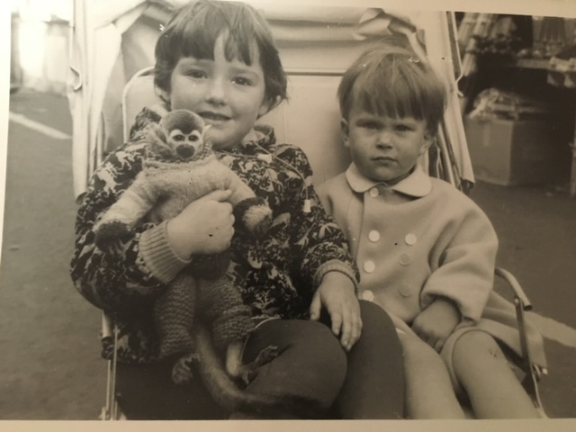 Two children hold a monkey at Hull Fair, c. 1960s