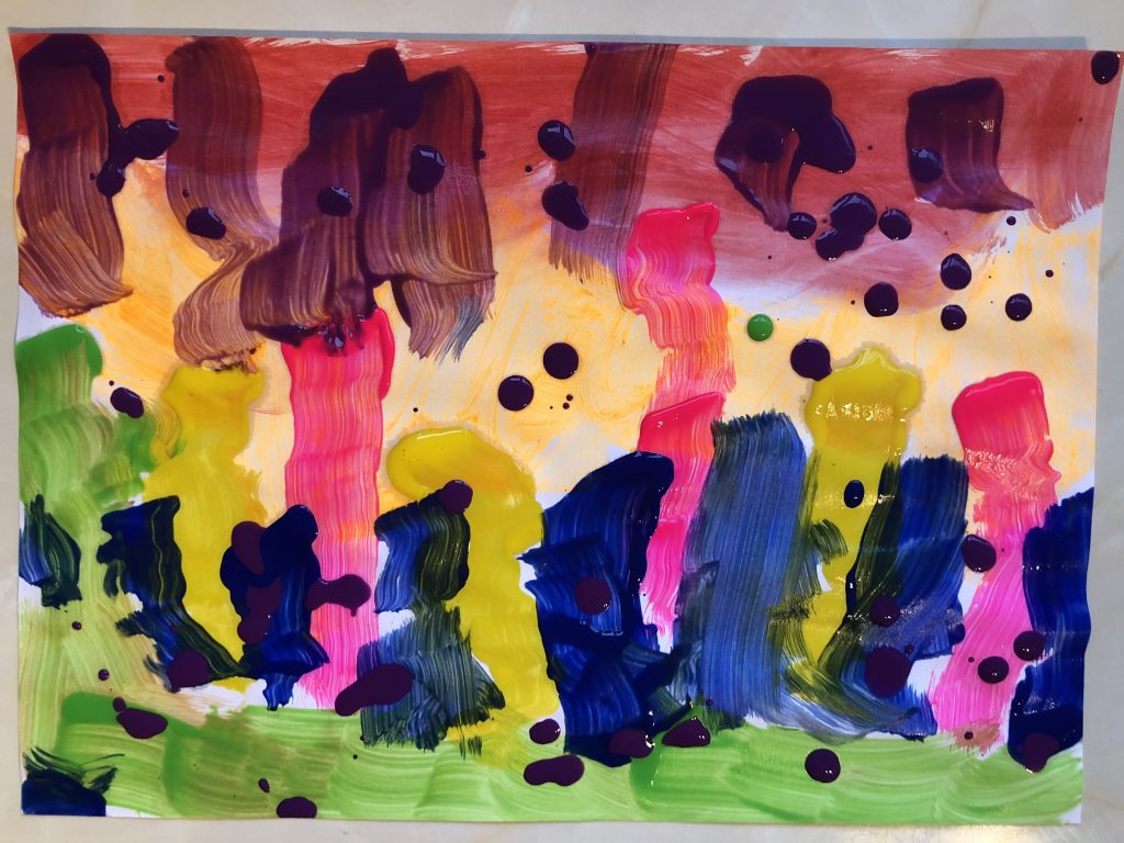 An abstract child's painting in rainbow colours.