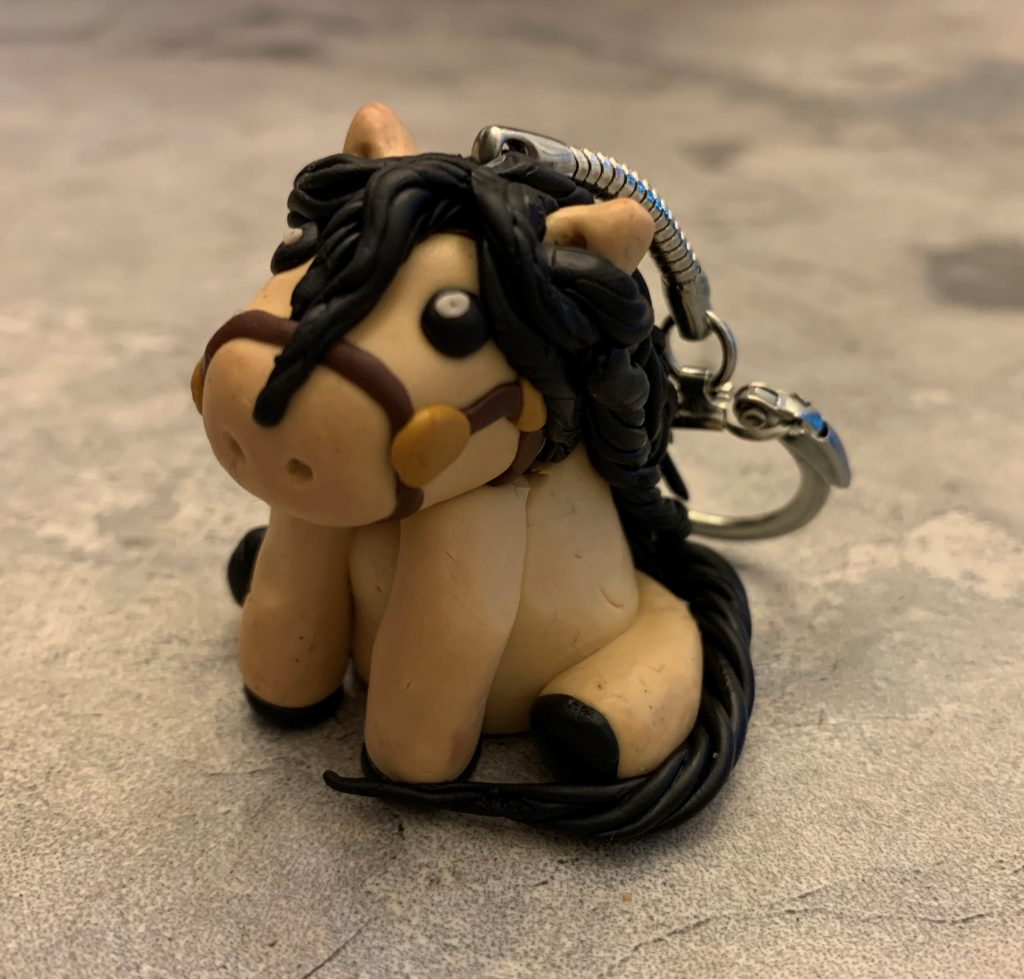 Clay figurine of a horse.