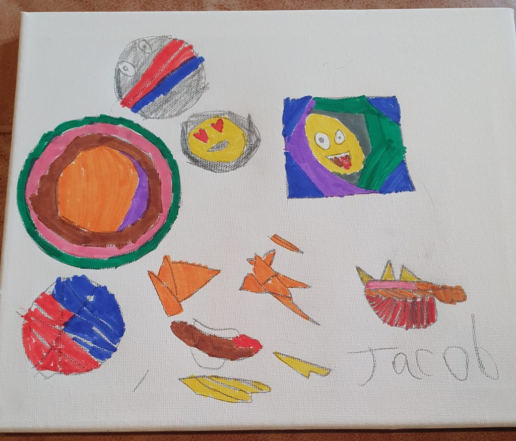 A child's artwork of different circular shapes and emojis.